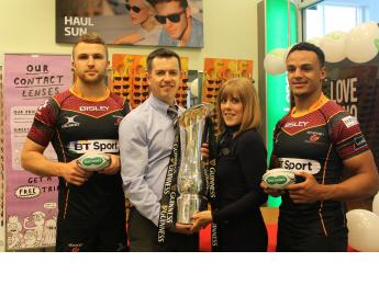 Newport Gwent Dragons stars and Specsavers staff with Guinness PRO12 trophy