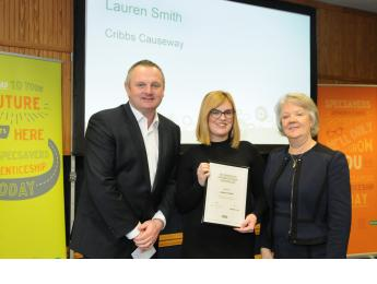 Specsavers apprenticeship graduate Lauren Smith with Dame Mary Perkins and Paul Marshall e