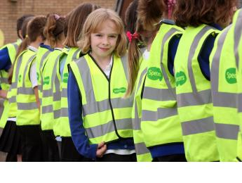 A young girl modelling her high vis vests